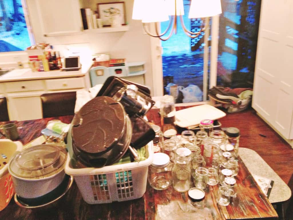 kitchen table full of dishes and items to be decluttered