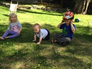 toddlers playing in yard, simple on purpose