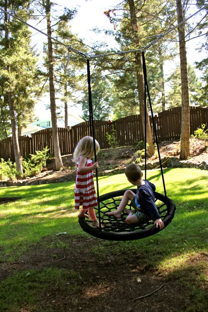 kids playing in yard backyard swing
