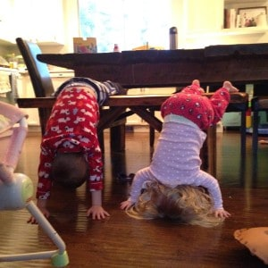 toddlers playing at dining table