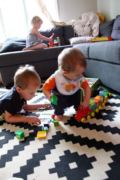 baby and preschooler playing lego