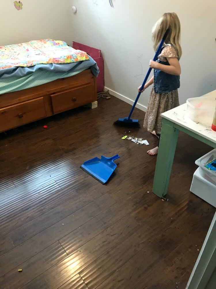 daughter sweeping bedroom
